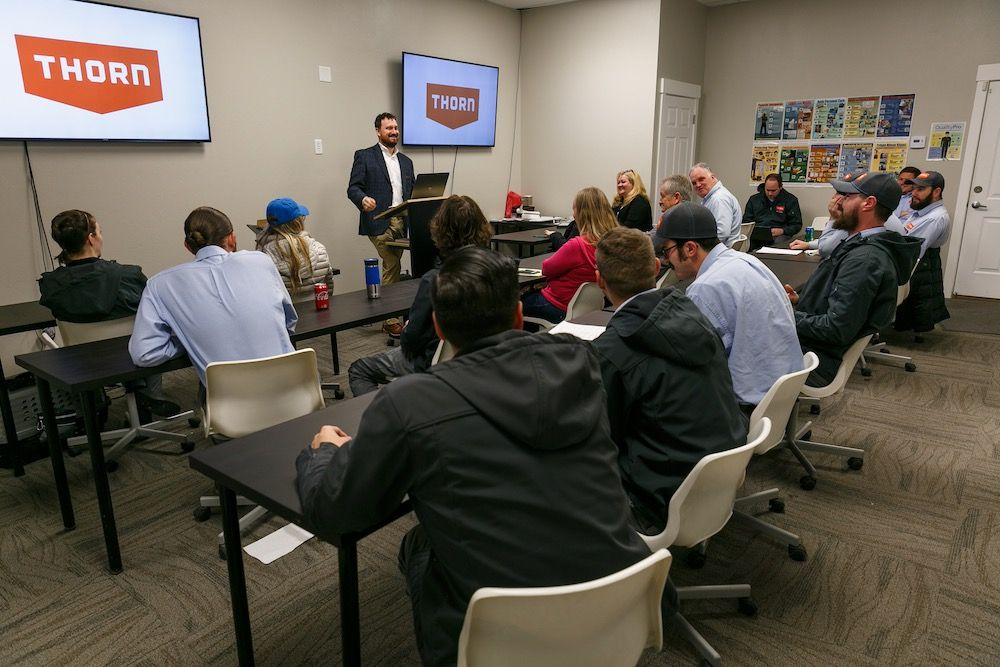 Kevin Thorn training employees in a classroom setting