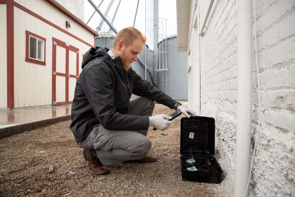 Thorn professional using an iPad to document activity in a black bait station